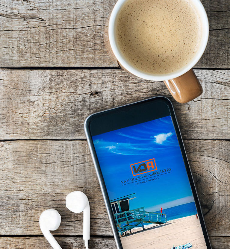 This image depicts a cellphone on a table next to a cup of coffee. Contacting us is quick and easy
